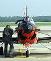US Navy 050622-N-6630C-010 Flight Instructor Lt. Jason Wells, assigned to Training Squadron Four (VT-4), left, preflights his T-34C Turbomentor as student Ens. Luis Diez sits in the cockpit prior to starting its engine.jpg