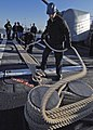 US Navy 060404-N-1045B-002 Sailors assigned aboard the Ticonderoga-class guided missile cruiser USS Monterey (CG 61) take in mooring lines while preparing to depart Naval Station Norfolk.jpg
