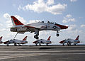 US Navy 060430-N-6484E-023 A T-45A Goshawk trainer jet prepares to land on the flight deck aboard the Nimitz-class aircraft carrier USS Theodore Roosevelt (CVN 71).jpg