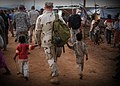 US Navy 061202-F-4925S-052 U.S. Navy Lt. Cmdr. Jeff Weitz walks holding hands with two children who live in a tent city set up by Combined Joint Task Force-Horn of Africa (CJTF-HOA) after a severe flooding in Dire Dawa, Ethiopi.jpg