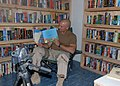 US Navy 070621-N-3560G-007 Lt. Cmdr. Russell Rang, assigned to Naval Mobile Construction Battalion (NMCB) 4, videotapes a story for his children while participating in the United Through Reading program.jpg