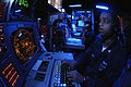 US Navy 071114-N-7883G-025 Operations Specialist 1st Class Marlon Patterson stands the ship's weapons coordinator watch in the combat direction center aboard the aircraft carrier USS Kitty Hawk's (CV 63).jpg