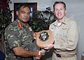 US Navy 071218-N-3925A-004 Capt. Billy Hart, commanding officer, USS Cleveland (LPD 7) presents a plaque to Brig. Gen. Moosa Ali Jaleel, Commanding General of Maldives National Defense Force's Quick Reaction Force.jpg