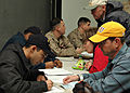 US Navy 090119-N-9134V-029 Sailors and Marines account for evacuees during a non-combatant evacuation operation exercise.jpg