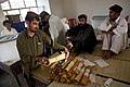 US Navy 090821-M-0440G-031 Afghan presidential election workers count and organize election ballots at a local school in the Nawa District.jpg