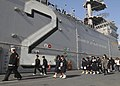 US Navy 091125-N-9950J-116 tudents from Hiu Junior High School tour the amphibious assault ship USS Essex (LHD 2).jpg