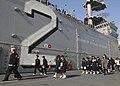 US Navy 091125-N-9950J-116 tudents from Hiu Junior High School tour the amphibious assault ship USS Essex (LHD 2).jpg