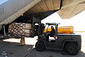 US Navy 100127-N-7918H-058 Aviation Warfare Specialist Jason Laplant unloads relief supplies at Leeward Air Field at Guantanamo Bay, Cuba.jpg