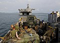 US Navy 100204-N-9950J-365 Marines assigned to the 31st Marine Expeditionary Unit return to the forward-deployed amphibious assault ship USS Essex (LHD 2) on a landing craft utility vehicle.jpg