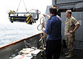 US Navy 100818-N-8959T-206 Vice Adm. Mark Fox, right, watches as the crew of HMS Chittingfold (M37) lowers Sea Fox, a mine neutralizer vehicle, into the water.jpg