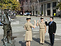 US Navy 101031-O-9999K-002 Ensign Kristin Hagedorn, left, administers the oath of reenlistment to her mother, Chief Yeoman Kathy Kules, and the oat.jpg