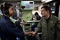 US Navy 101214-N-7981E-226 Vice Adm. Allen G. Myers meets Machinist's Mate 3rd Class Taylor Fenton while touring the waste processing room aboard U.jpg