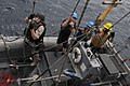 US Navy 110817-N-DU438-348 Sailors hold on as their RHIB is lowered.jpg