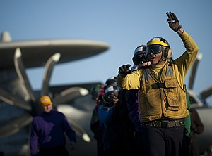 US Navy 120120-N-DR144-349 A Sailor leads a hose team during a flight deck firefighting drill.jpg