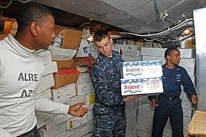 US Navy 120121-N-NB694-110 Sailors assigned to the Nimitz-class aircraft carrier USS Abraham Lincoln (CVN 72) put away supplies during a replenishm.jpg