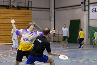 Ultimate (sport) - The marker blocking the handler's access to half of the field. Tartu, Estonia.