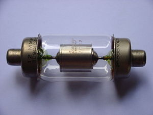 Glass-to-metal seal - Uranium glass used as lead-in seals in a vacuum capacitor
