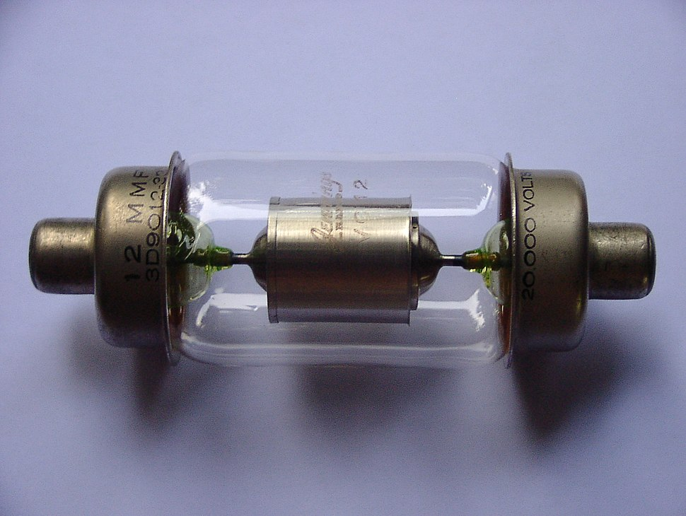 A glass cylinder capped on both ends with metal electrodes. Inside the glass bulb there is a metal cylinder connected to the electrodes.