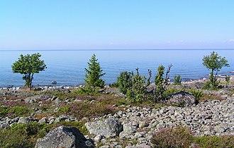 Holmöarna - The coast of Holmön island with the mainland showing as a narrow line on the horizon