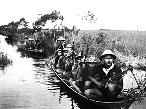 Viet Cong - Guerrilla forces from North Vietnam's Vietcong movement cross a river in 1966 during the Vietnam War