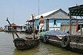 Vietnam, Chau Doc, Houses on Bassac River.jpg