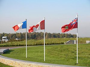 Canadian Red Ensign - From left to right: the Flag of France, the Maple Leaf Canadian flag, and the Canadian Red Ensign fly at the Canadian National Vimy Memorial in France