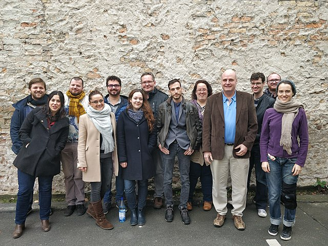 https://upload.wikimedia.org/wikipedia/commons/thumb/c/c3/Volunteer_Supporters_Meeting_2017_in_Berlin%2C_Germany.jpg/640px-Volunteer_Supporters_Meeting_2017_in_Berlin%2C_Germany.jpg