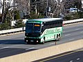 Wellesley Shuttle on Mass Pike in Allston, December 2015.JPG