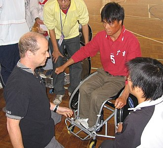 Wheelchair rugby - Wheelchair rugby classifier examining a new player