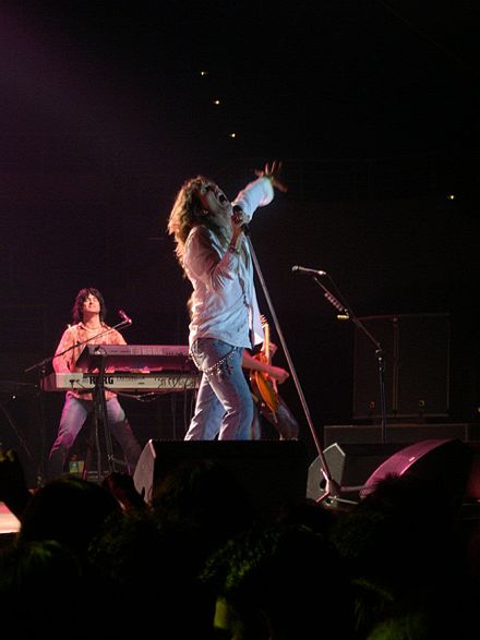 Whitesnake performing in June 2003 Whitesnake band 1.jpg