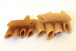 Whole wheat penne, cooked and uncooked.jpg
