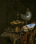 Willem Kalf - Pronk Still Life with Holbein Bowl, Nautilus Cup, Glass Goblet and Fruit Dish - Google Art Project.jpg