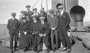 Winnipeg Falcons - Picture of the Gold Medal-winning Winnipeg Falcons taken en route to the 1920 Olympics (photo includes an unidentified ships' officer and a woman)