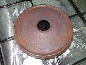 Wonder Pot - Metal disc placed between the Wonder Pot and the flame