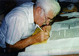 Ancient Hebrew writings - A sofer stam writing a Sefer Torah.
