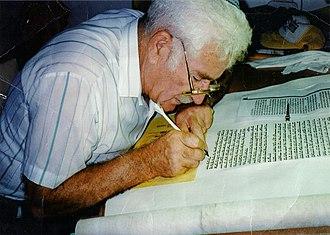 Ancient Hebrew writings - A sofer stam writing a Sefer Torah.