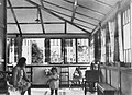 Young child and her mother in the enclosed verandah of a home (8760985107).jpg