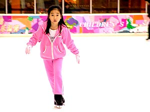 A young girl, ice-skating