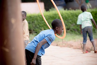 Hula hoop - A boy hula hooping using his neck in Lusaka