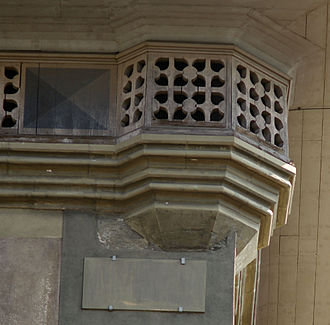 Zytglogge - Detail: wooden Gothic whisker cornice, corner towerlet base and decorative plating.