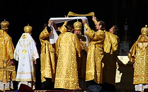 Lavabo - Patriarch Kirill I of Moscow washing his hands at the Great Entrance during an outdoor Divine Liturgy.