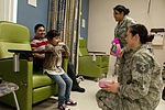 163rd Reconnaissance Wing delivers holiday cheer to children's hospital 131217-Z-UF872-005.jpg