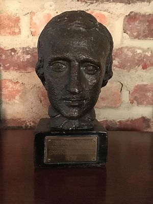 "Raven Society - Photograph of the Raven Award with bust of Edgar Allan Poe (inscribed–""Raven Award, Univ. of Virginia, Carrington Harrison, 1936"")"