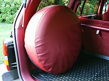 8230b3b3808a Full size spare tire mounted in cargo space area of a 1993 Jeep Grand  Cherokee