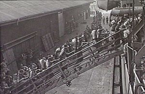 2/28th Battalion (Australia) - 2/28th troops board a troopship in Cairns, August 1943, prior to the landing around Lae