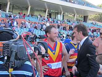 Tony Modra - Modra (left) being interviewed in October 2011