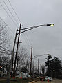 2014-12-20 15 47 55 Mercury vapor street lights active during the day at the New Jersey Department of Transportation Headquarters along Parkway Avenue (Mercer County Route 634) in Ewing, New Jersey.JPG