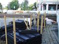 2016-10-02 road works at Berliner Platz (building materials).png
