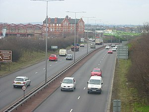 Longton, Staffordshire - The A50 near to its cutting. The prominent building is Longton's library.