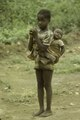 ASC Leiden - F. van der Kraaij Collection - 01 - 081 - A child with folded hands carries a younger child in a carrying cloth on the back (cf 33) - Montserrado County, Liberia, 1976.tiff